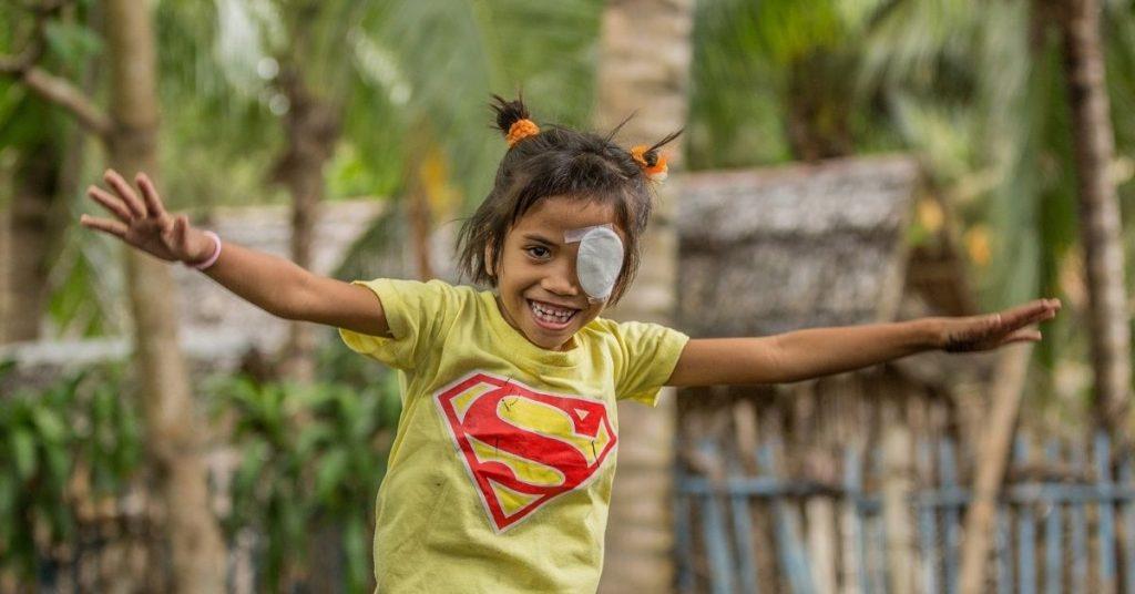 marjil celebrates a successful eye surgery